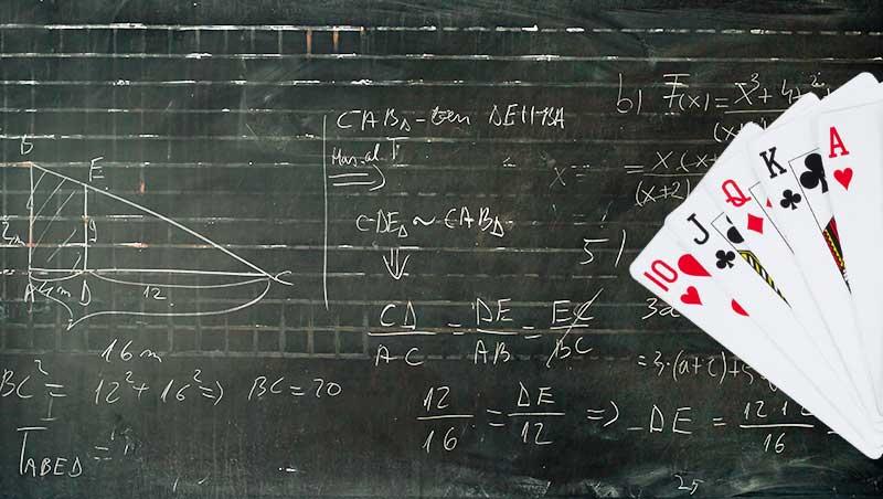 Playing card on a blackboard